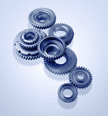 Metal gears on blue background Stock Photo