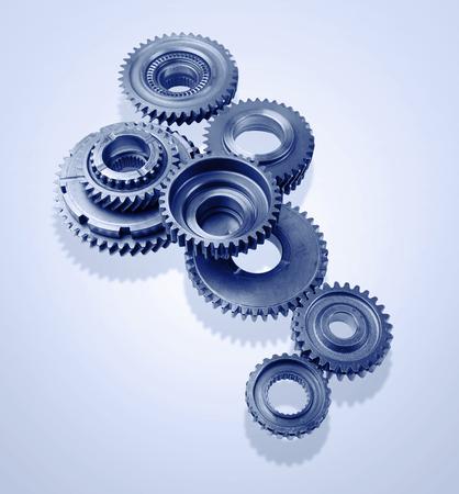 interlink: Metal gears on blue background Stock Photo
