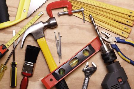 hardware tools: Assorted work tools on wood