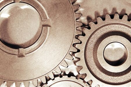 interlock: Metal cog gears joining together