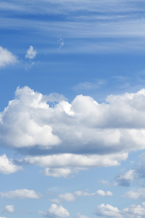 Fluffy white clouds in sky Stock Photo
