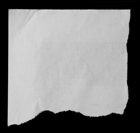 torn: Piece of torn paper on black Stock Photo