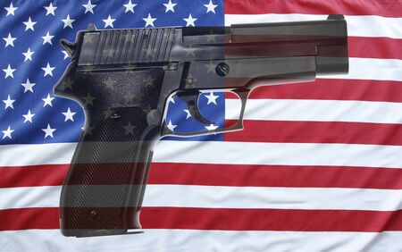 weaponry: Handgun in front of American flag Stock Photo