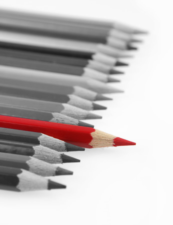 crowd: One red pencil standing out from others Stock Photo