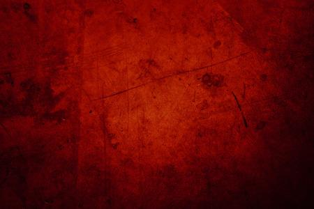 Red grunge textured wall background 写真素材