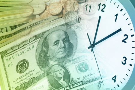 american currency: Clock and American currency. Time is money concept