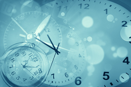 Clocks and abstract blue background Foto de archivo
