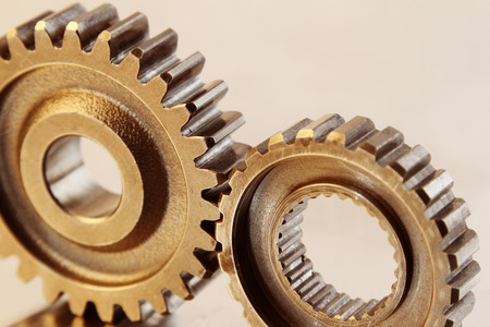 interlink: Closeup of two metal cog gears