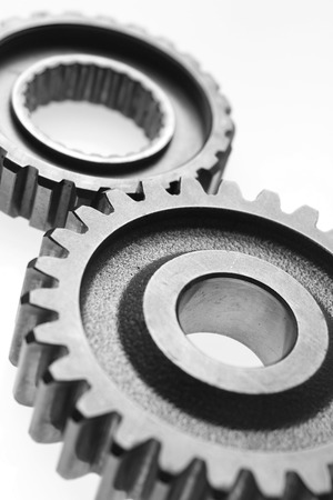 interlocked: Closeup of two metal cog gears