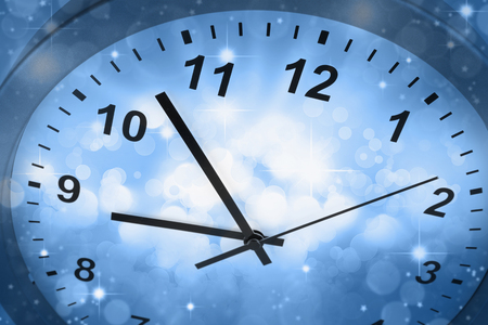 haste: Clock face and abstract background Stock Photo