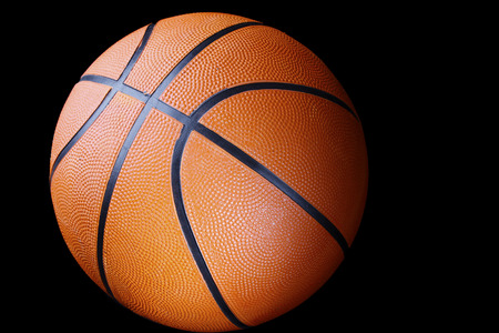 sport object: One basketball on dark background