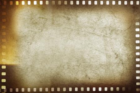 old paper: Film negative frames on brown background