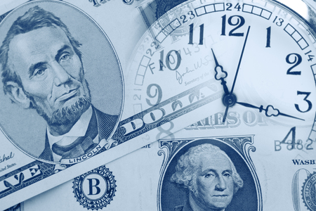 american currency: Clock faces and American currency Stock Photo