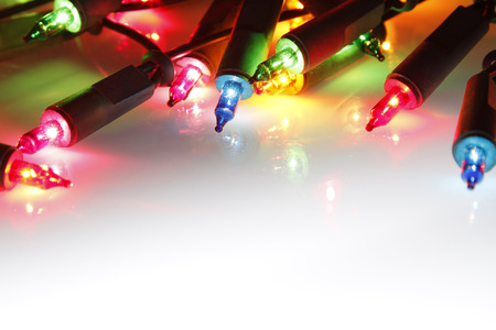 symbolical: Closeup of Christmas lights glowing
