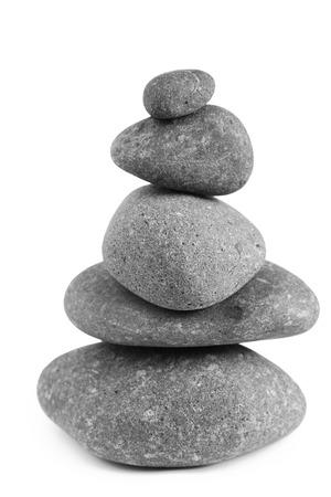 steadiness: Pile of balanced rocks on plain background