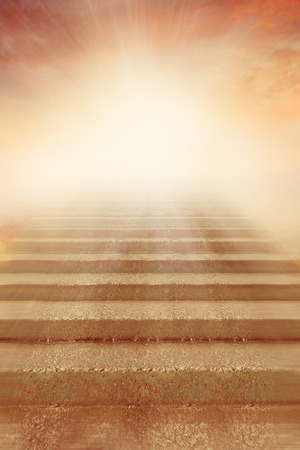 leading light: Stairway leading up to bright light Stock Photo