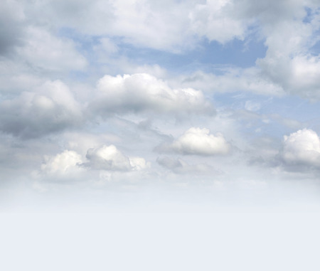 heaven light: Fluffy white clouds in sky Stock Photo