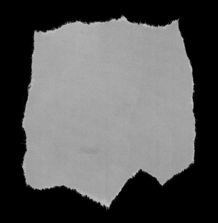 tearing: Piece of torn paper on black Stock Photo