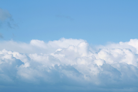 fluffy clouds: Fluffy white clouds in blue sky