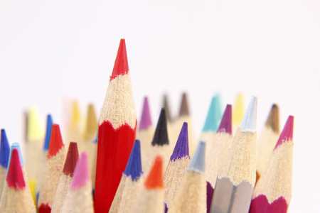 color pencil: Red pencil standing out from others