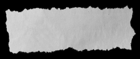 fray: Piece of torn paper on black Stock Photo