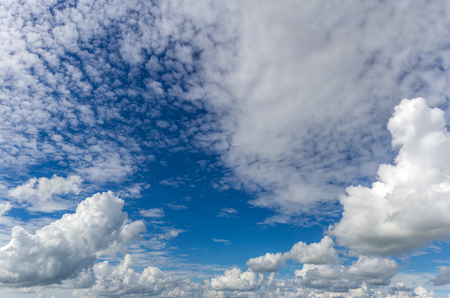 fluffy: Fluffy clouds in a blue sky Stock Photo