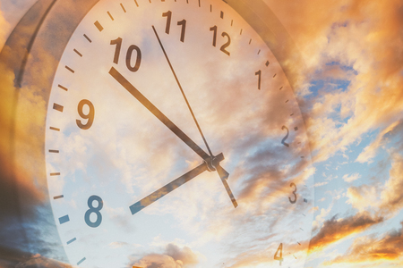 Clock face in bright sky Stock Photo