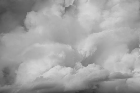 fluffy clouds: Grey fluffy clouds in sky Stock Photo