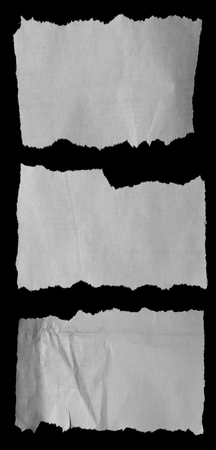 Pieces of torn paper on black. Stock Photo