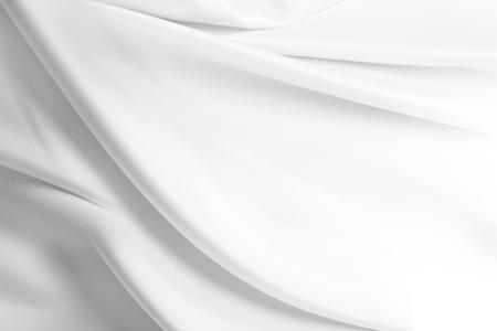 Closeup of rippled white silk fabric 스톡 콘텐츠