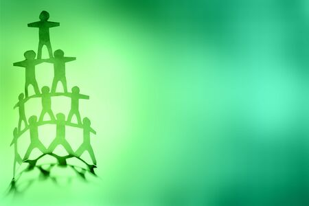 Human team pyramid supporting each other Stock Photo