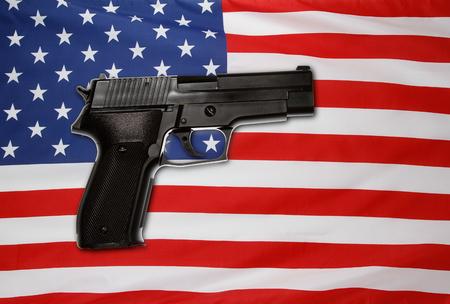 Handgun in front of American flag Stok Fotoğraf