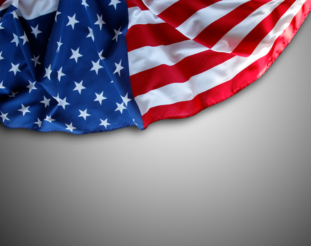 Closeup of American flag on grey background Imagens
