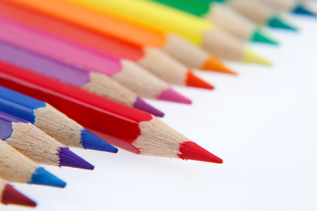 One red pencil standing out from others Stock Photo