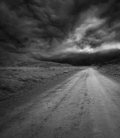 Empty road and dark sky Фото со стока