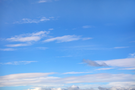 Fluffy white clouds in a blue sky Stock Photo
