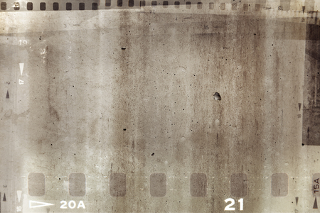 Film negative frames on brown background Stock Photo