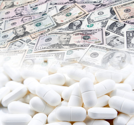 Pills and American banknotes. Cost of health care Stock fotó