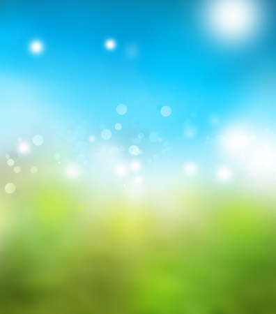 Blurry green meadow and blue sky spring background  版權商用圖片