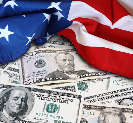 American flag and assorted American banknotes