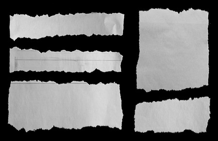 Five pieces of torn newspaper on black background Imagens