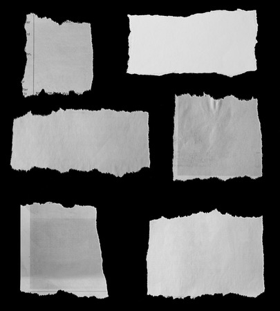 Six pieces of torn newspaper on black background