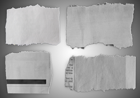 Pieces of torn paper on grey background
