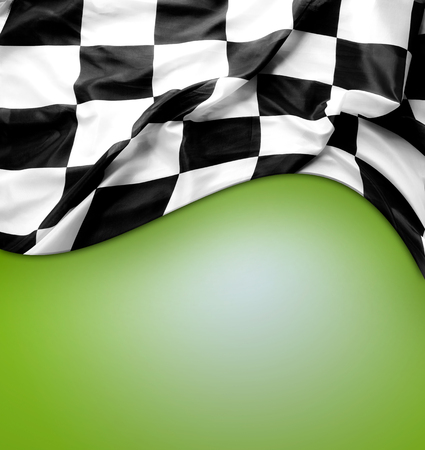Checkered black and white flag on green background