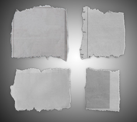 Pieces of torn paper on grey background  Imagens