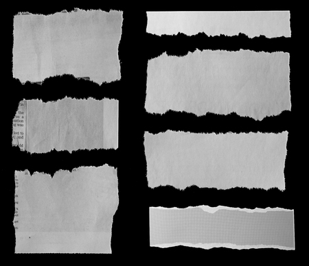 Seven pieces of torn newspaper on black background Imagens