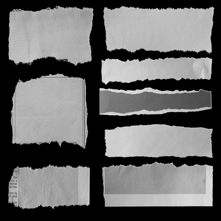 Eight pieces of torn newspaper on black background