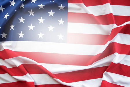 Closeup of rippled American flag. Copy space