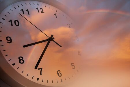 Clock face in bright sky. Time passing