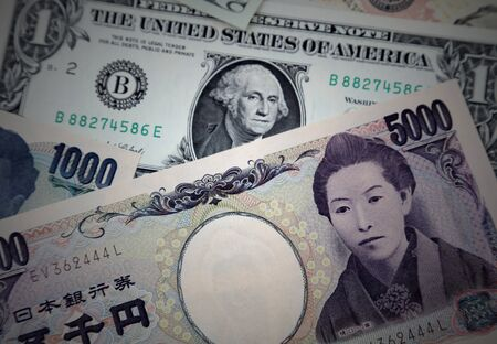 Close-up of American and Yen banknotes